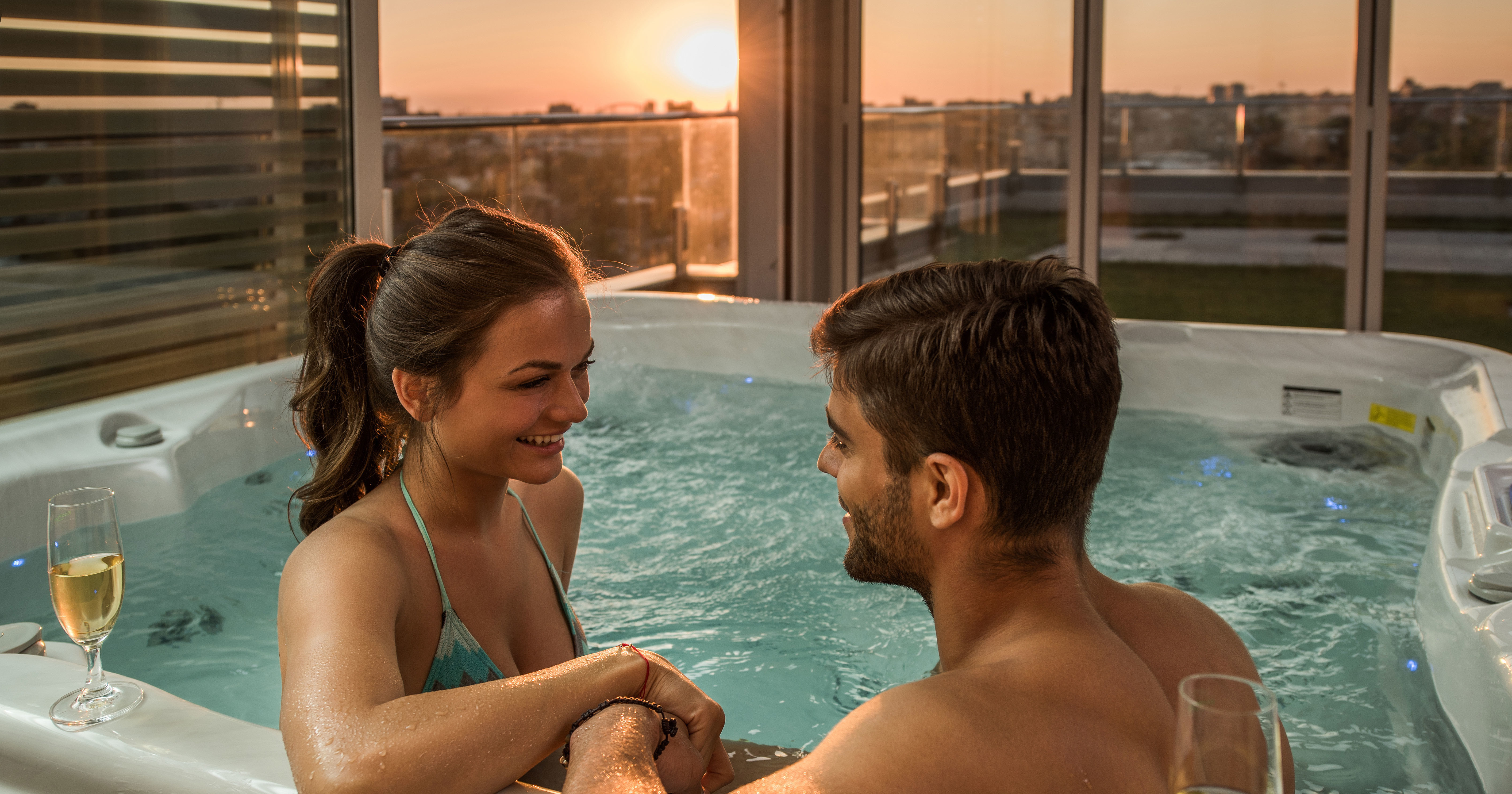 Young couple in a hot tub with nice skyline